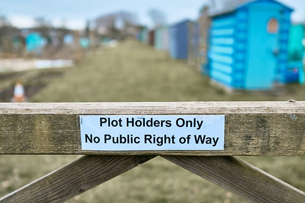 a sign on an allotment fence saying plot holder only
