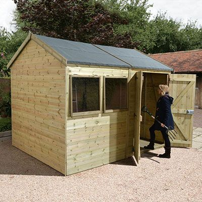 large wooden shed with double doors and two windows featuring a reverse apex build and a woman walking into the shed