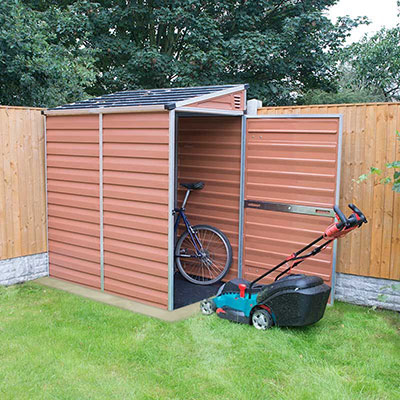 4x6 amber-coloured, pent, plastic shed in a  garden