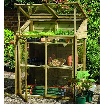 a small, wooden lean-to greenhouse with open doors and vents
