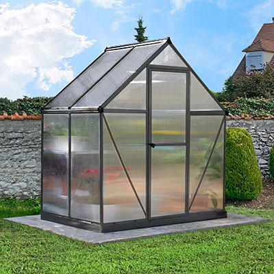 a small polycarbonate greenhouse with a grey frame