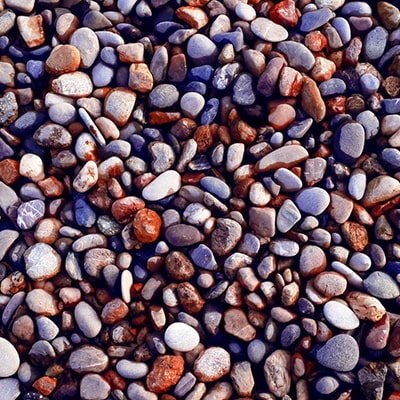 a pile of colourful gravel sized stones