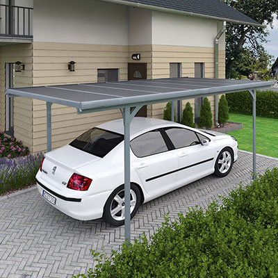 a white car underneath a grey polycarbonate carport