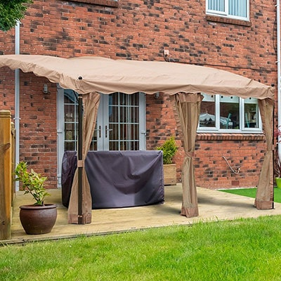 A 13x10 brown lean-to garden gazebo covering a decked area.