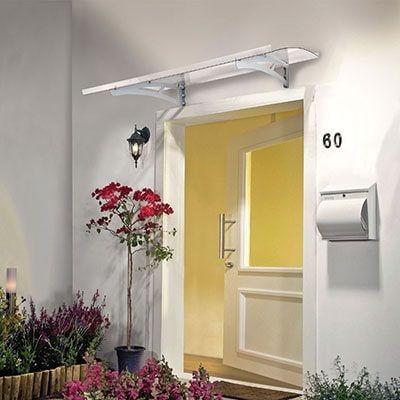 a white rain protector entryway cover above an open door
