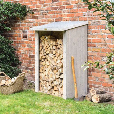 a grey timber log store with axe