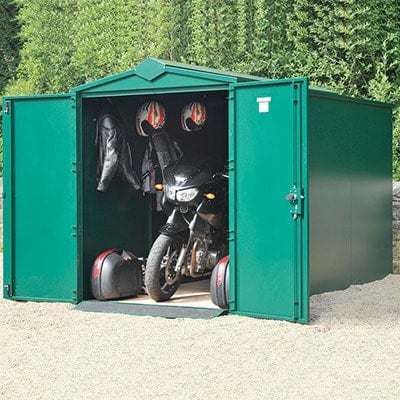 a very secure, green motorbike garage with its doors open to reveal a bike