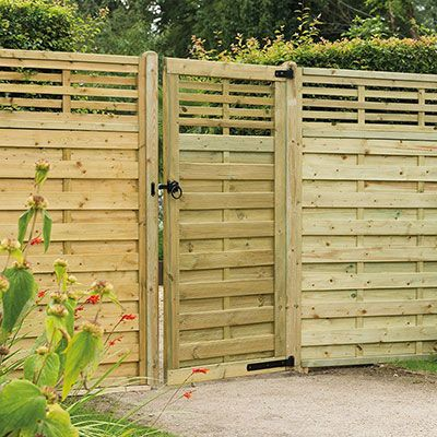 a modern garden gate and matching fence panels, all with slatted tops
