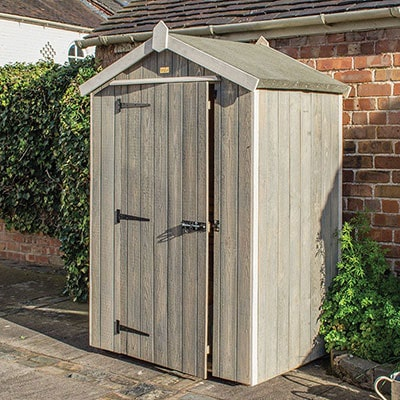 a grey, wooden tool shed with an apex roof and single door