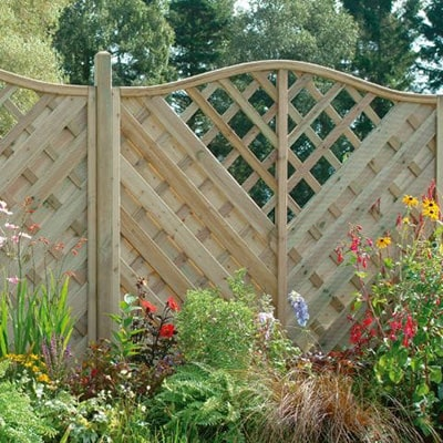 decorative fencing with a v-shaped trellis section on each panel