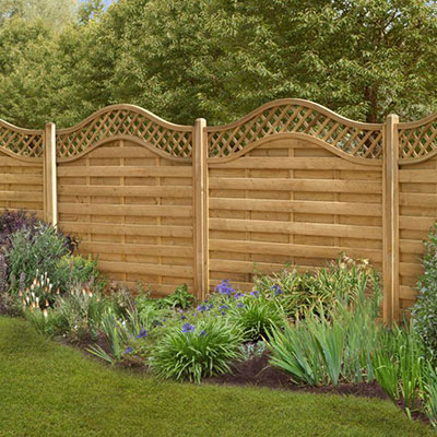 decorative fencing with a scalloped top trellis section