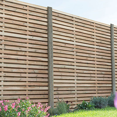 A run of contemporary double slatted fence panels.