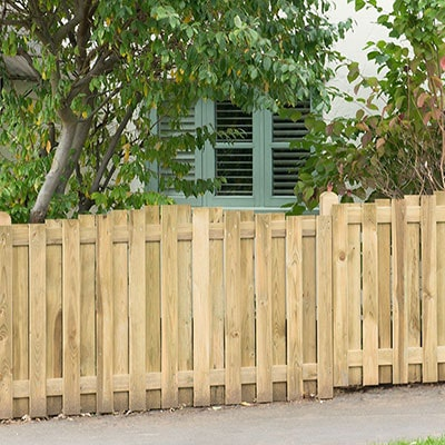 A run of hit and miss, contemporary fence panels.