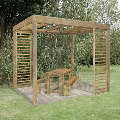 A wooden pergola, with slatted panels, above a wooden table and benches