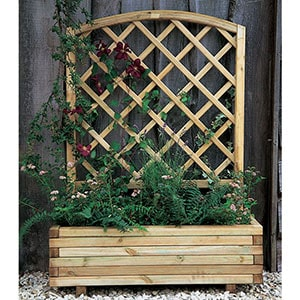 The Forest Toulouse Wooden Garden Planter full of plants, which are growing up its trellis back.