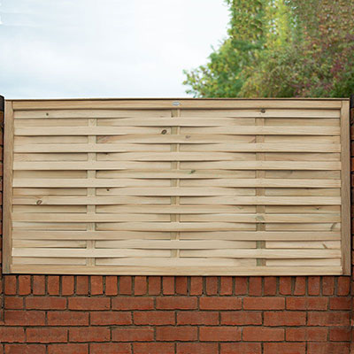 a decorative fence panel with woven slats, mounted on a wall