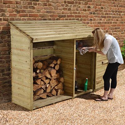 a woman stood outside a log shed, which includes an integral tool compartment