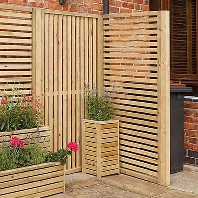 A pair of slatted, wooden screens/ fence panels behind a matching planter