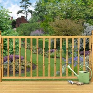 A wooden deck railing kit with turned Edwardian spindles.