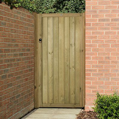 a wooden side gate made from vertical tongue and groove boards