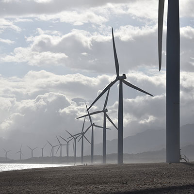 wind turbines on a beach