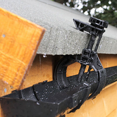 black shed guttering attached to a shed roof