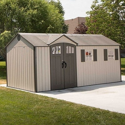 An attractive plastic shed with double doors and charming windows