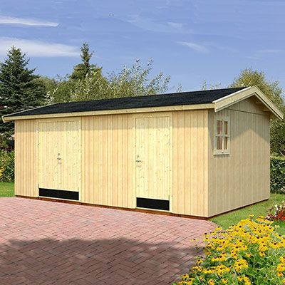 a large reverse apex shed with 2 sets of doors, 1 window and very thick walls