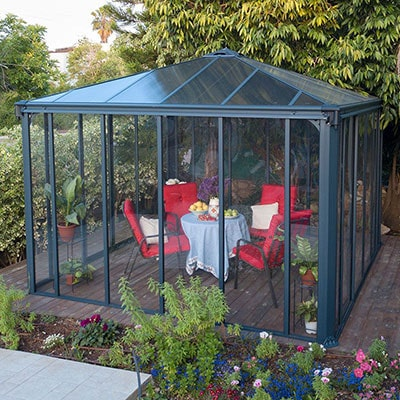 An enclosed, polycarbonate gazebo, with a grey aluminium frame