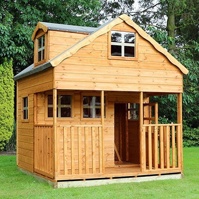 a 2 storey wooden playhouse with a veranda and 6 windows