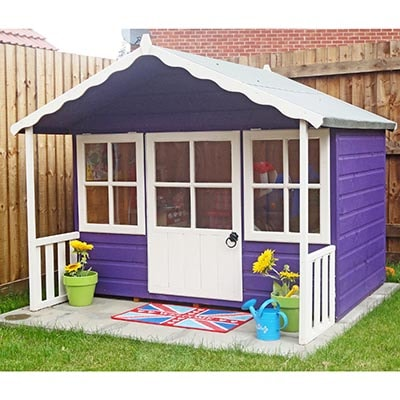 a wooden Wendy house, painted purple and white, with a veranda