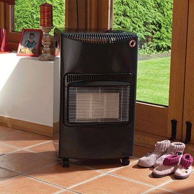 a grey summer house heater, positioned next to double doors
