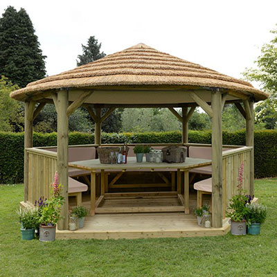 A large garden gazebo, made of wood and with a thatched roof
