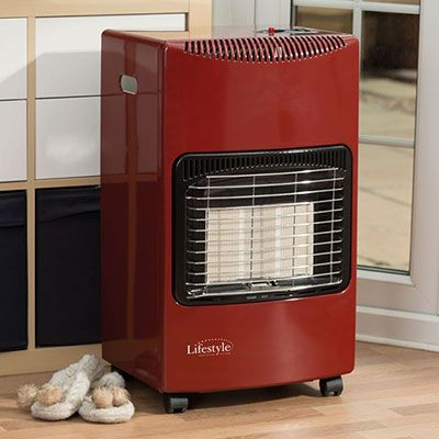 a red portable gas cabinet heater next to a pair of slippers