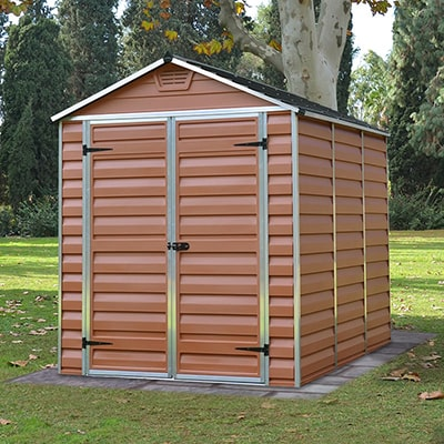A reddish brown plastic shed with an apex roof and double doors