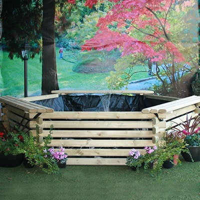 A 300-gallon, raised, wooden fish pond