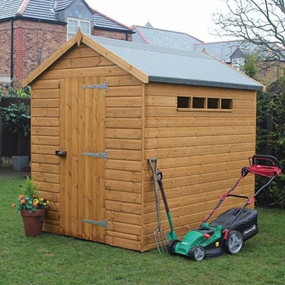 a wooden security shed with an apex roof