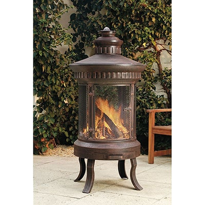 A large, round fire pit with 4 legs