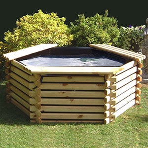 A raised, wooden fish pond with sump, positioned on a lawn.