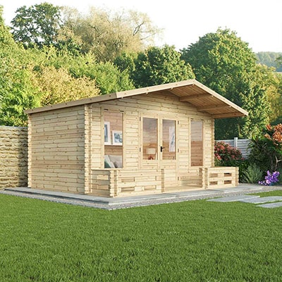A charming garden log cabin with large overhang roof and a veranda