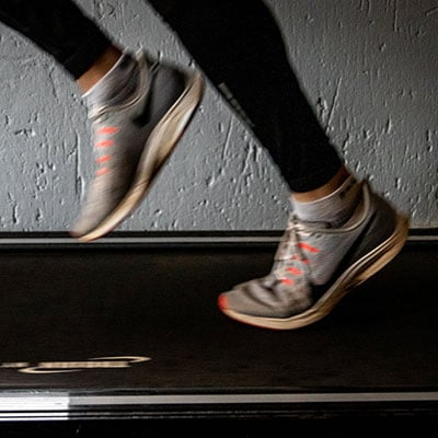 a photo of a person's legs and feet on a treadmill