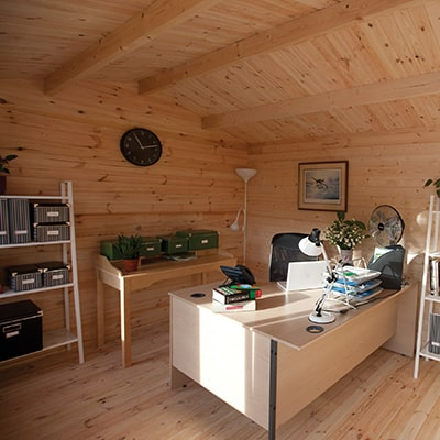 The interior of the  Forest Garden Chiltern Log Cabin being used as a garden office