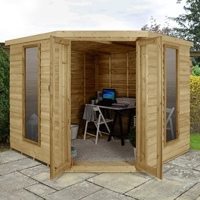 A corner summerhouse used as a garden office for working from home