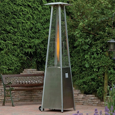 a tall, grey gas patio heater in front of a garden bench