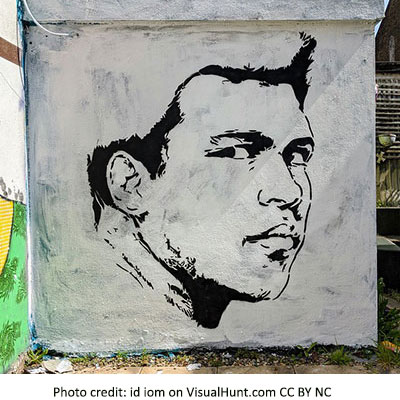a drawing of Mohammed Ali on a shed wall