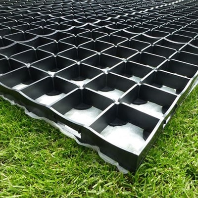 a black plastic shed base with interlocking grids