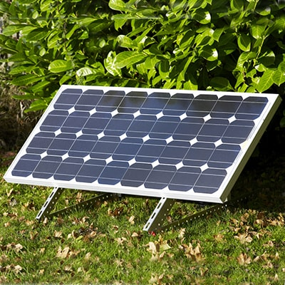 a solar panel positioned on a lawn