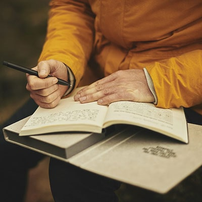 a man writing in a diary