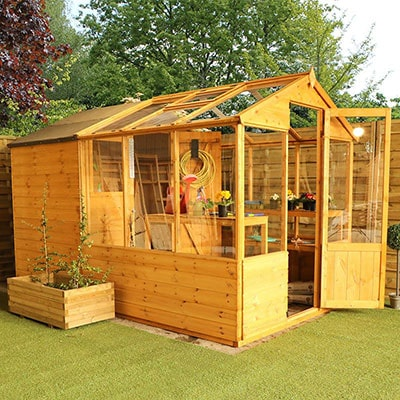 a greenhouse and potting store wooden combi shed