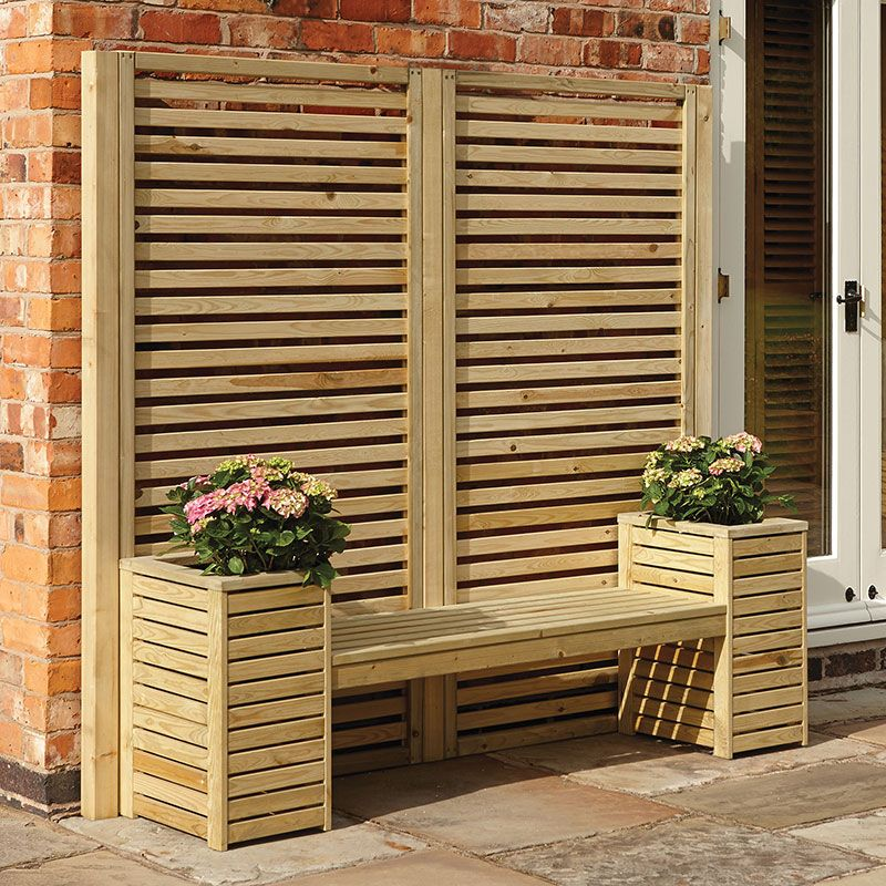 A wooden garden bench with planters positioned either side and a decorative, wooden screen to the rear.